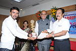 Sri. B. M. Parthasarathy. Hon. Treasurer, Seshadripuram Educational Trust distributing  prizes for  winners.