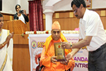 Swamy Tyagishwarananda was felicitated by Dr. M. Prakash, Director of Studies, Seshadripuram Educational Trust